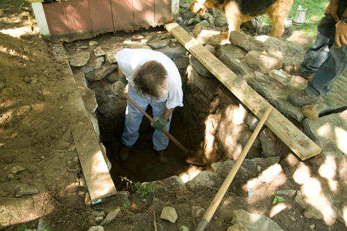 excavation under the outhouse to look for treasure
